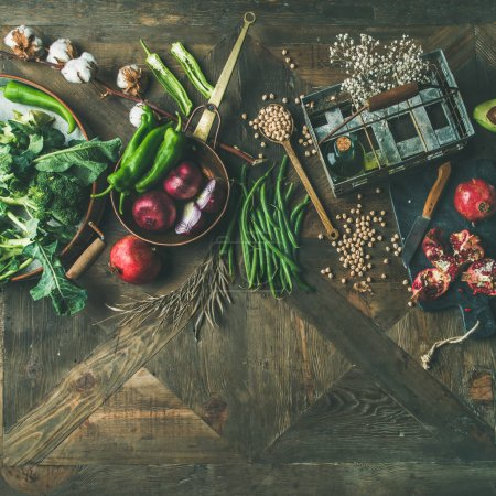 Winter vegetarian, vegan food cooking ingredients over wooden background