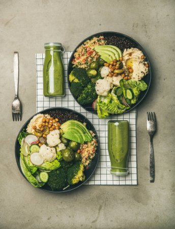 Photo for Healthy dinner, lunch setting. Flat-lay of vegan superbowls or Buddha bowls with hummus, vegetables, fresh salad, beans, couscous and avocado and green smoothies in bootles, top view. Vegetarian food - Royalty Free Image