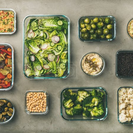 Photo for Healthy vegan dishes in containers. Flat-lay of vegetable salads, legumes, beans, fermented olives, sprouts, hummus dip, couscous for take-away lunch, top view, square crop. Spring menu, clean eating - Royalty Free Image