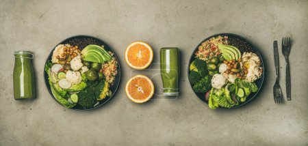 Photo for Healthy dinner, lunch setting. Flat-lay of vegan superbowls or Buddha bowls with hummus, vegetable, salad, beans, couscous, avocado and green smoothies in bootles, top view. Clean eating food concept - Royalty Free Image