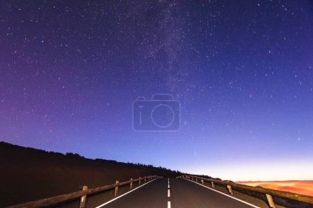 Photo for Night sky - a milky way over the road at night - Royalty Free Image