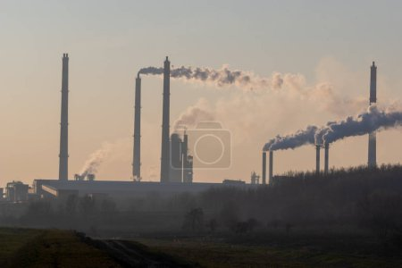 Photo for Plant chimneys with smoke, environmental pollution - Royalty Free Image