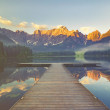 Sunrise over the crystal-clear mountain lake in th...
