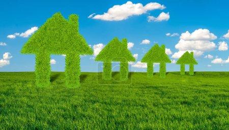Photo pour Concept de maisons écologiques vertes sur une prairie verte contre le ciel bleu - image libre de droit