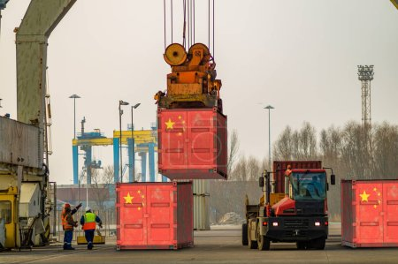 Photo for Cargo container with the china flag during unloading at the port - Royalty Free Image