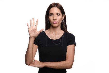 Photo pour Isolé en fond blanc brunette femme disant arbre en langue des signes espagnole - image libre de droit