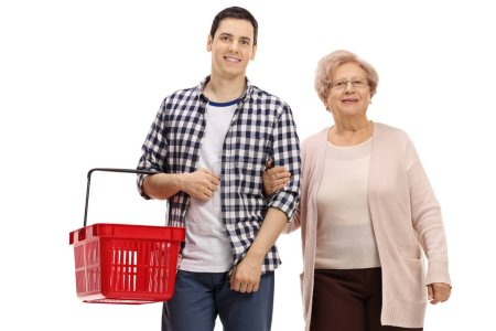 Photo for Young man with a shopping basket and an elderly woman isolated on white background - Royalty Free Image