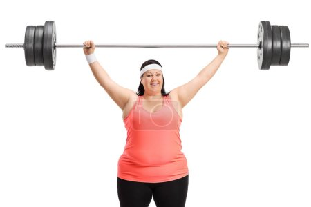 Overweight woman working out with a barbell isolated on white background