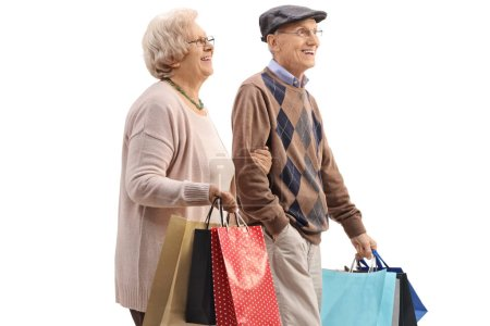 Senior couple with shopping bags isolated on white background