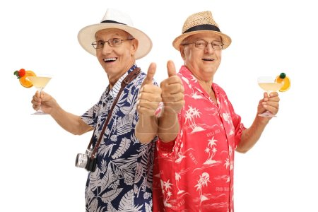 Elderly tourist with cocktails making thumb up gestures isolated on white background