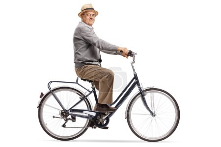 Senior riding a bike and looking at the camera isolated on white background