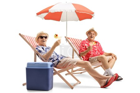Elderly tourists with cocktails sitting in deck chairs isolated on white background
