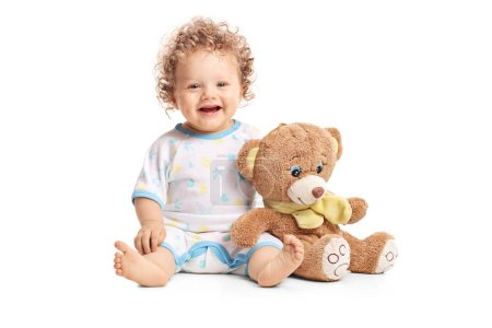 Baby boy with a teddy bear isolated on white background