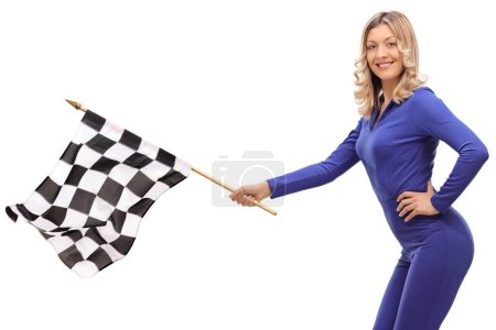 Young woman in a racing suit waving a checkered race flag isolated on white background