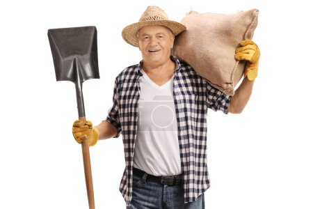 Elderly farmer with a shovel and a burlap sack isolated on white background