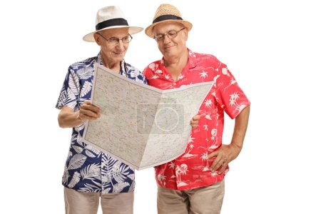 Elderly tourists looking at a map isolated on white background