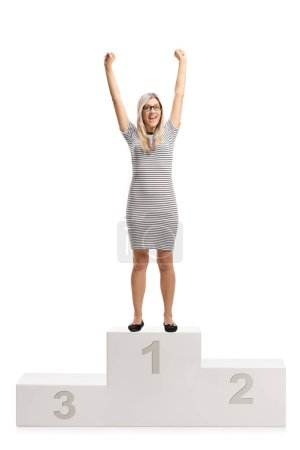 Photo for Full length portrait of an overjoyed young woman standing on a winners pedestal isolated on white background - Royalty Free Image