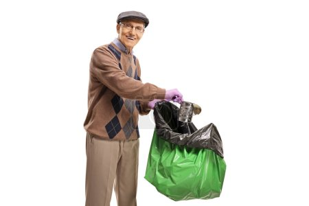 Photo for Elderly man collecting garbage in a plastic bag isolated on white background - Royalty Free Image