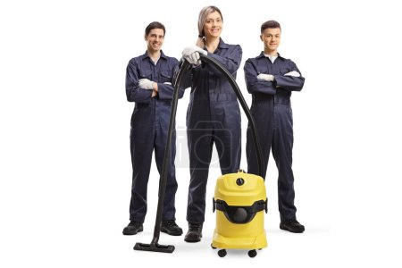 Photo for Full length portrait of a team of cleaners in uniforms with a vacuum cleaner isolated on white background - Royalty Free Image