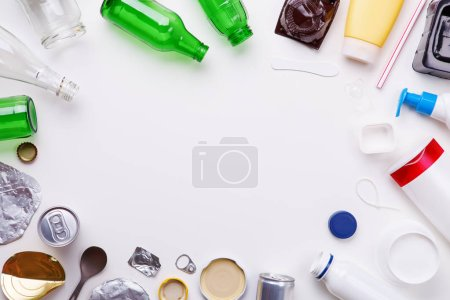 Photo for Selection of garbage for recycling - metal, plastic, and glass on white background. Concept of recycling - Royalty Free Image