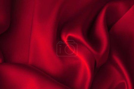 Photo pour Luxe rouge brillant tissu satin tissu abstrait fond ondulé - image libre de droit