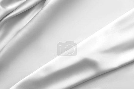 Photo pour Ondulé tissu de soie blanche tissu satiné vagues fond glamour - image libre de droit