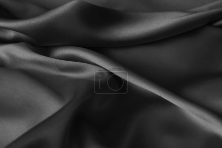 Photo for Black luxury wavy rippled glossy silk drapery cloth fabric. Abstract background - Royalty Free Image