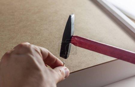 close up hammering a nail