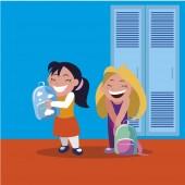 happy little schoolgirls in the school corridor