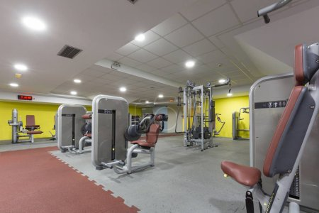 Photo for Interior of a gym with equipment - Royalty Free Image