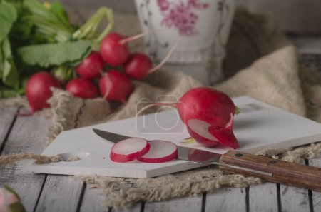 Photo for Bio radishes cuttting on wood table, food photography - Royalty Free Image