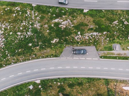 Bird's eye top view of serpentine route with parked car. Turns of Hochtor Pass. Mountains road