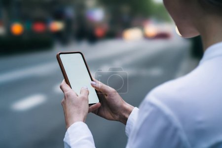 Photo for Cropped view of female fingers chatting online in social networks on blank display of modern smartphone using 4g internet on blurred background.Female blogger making payment on website on telephone - Royalty Free Image