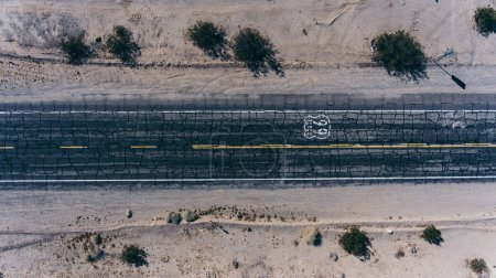 American landmark roadside in wild environment, view of asphalt old highway with name Route 66 for transportation crossing United states in Arizona desert
