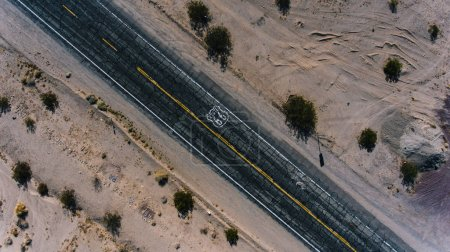 Top scenery view of old famous interstate highway in America Route, aerial view of cracked asphalt road for transport located in desert national park