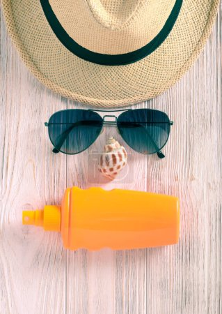 Photo for Summer holiday concept background: hat, sunglasses, sunscreen cream - Royalty Free Image