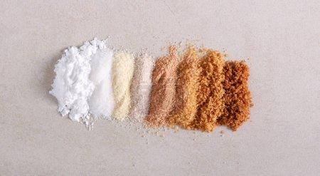 Photo pour Différents types de sucre, sur la surface de la pierre - image libre de droit