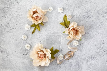 Photo for Round  frame border of pink and white rose flowers on grey marble background. - Royalty Free Image