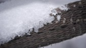 Ice on a brown rattan surface