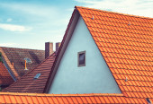 Modern European rooftops with tiles and chimneys