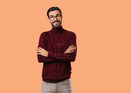 Photo for Young natural man crossing arms, smiling and relaxed - Royalty Free Image