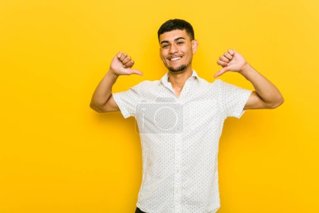 Young hispanic man feels proud and self confident, example to follow.