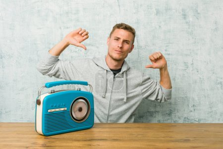 Young caucasian man listening to the radio feels proud and self confident, example to follow.