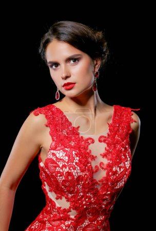 Photo for Pretty young model female with dark hair in amazing long red dress . - Royalty Free Image