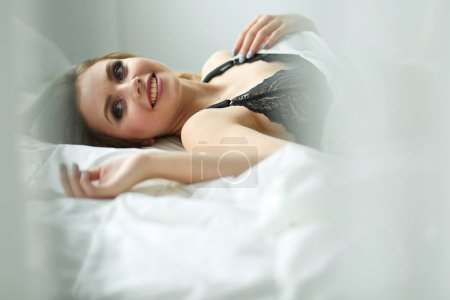 Sexy fashionable woman on the bed