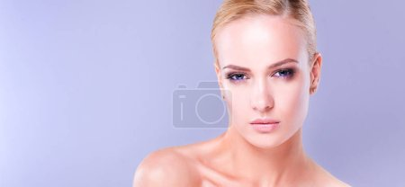 Photo for Portrait of a beautiful woman , isolated on gray background. - Royalty Free Image