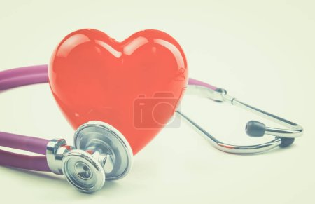 Photo for Red heart and a stethoscope on desk. - Royalty Free Image