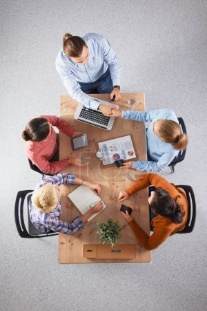Photo for Business people sitting and discussing at meeting, in office. - Royalty Free Image