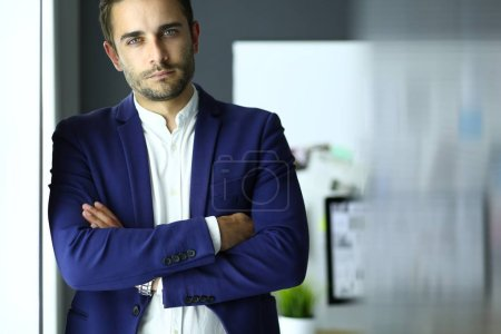 Photo for Portrait of young designer in front of laptop and computer while working - Royalty Free Image