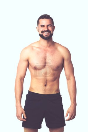 Photo for Portrait of a happy athletic man with muscular torso standing. - Royalty Free Image